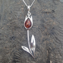 Large sterling silver tulip pendant with Baltic cognac amber