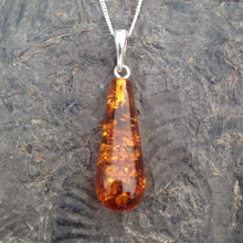 Baltic cognac amber drop pendant on sterling silver curb chain