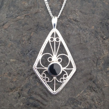 Diamond shaped sterling silver filigree pendant with round Whitby Jet stone
