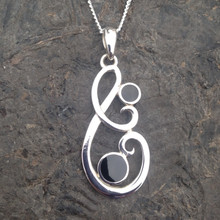 Large contemporary sterling silver swirl pendant with two hand carved round Whitby Jet stones