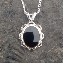 Small oval sterling silver and Whitby Jet pendant with rope and frill edge