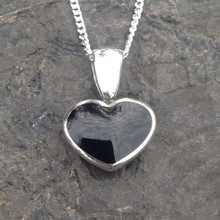 Small curved Whitby Jet and silver pendant