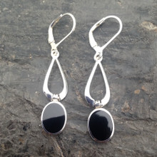 Long sterling silver earrings set with oval Whitby Jet stones