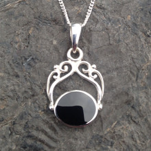 Whitby Jet and 925 silver fancy filigree pendant with oval stone