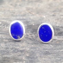 Oval sterling silver stud earrings with blue Lapis Lazuli stones