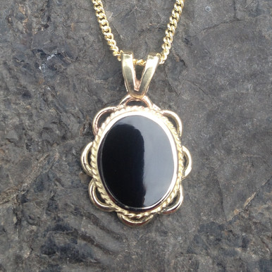 Whitby Jet and 9ct gold oval frill and rope edge pendant on gold curb chain