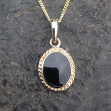 Oval rope edge 9ct gold pendant with Whitby Jet stone on 9ct gold chain