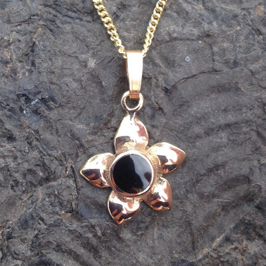9ct gold flower pendant with round hand carved Whitby Jet stone
