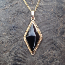 Hand crafted Whitby Jet and 9ct gold diamond shaped pendant on gold curb chain