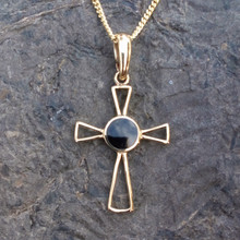 Whitby Jet and 9ct gold cross pendant on gold curb chain