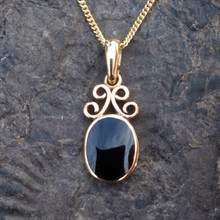 "Whitby Jet and 9ct gold scroll pendant on 18"" gold curb chain"