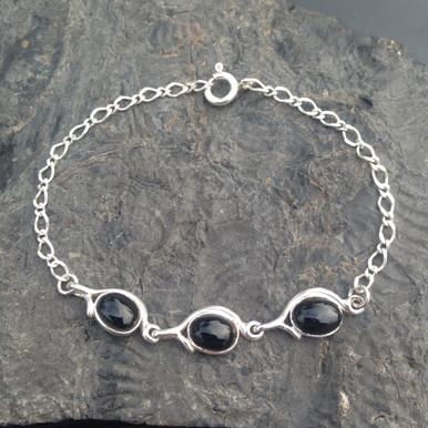 Sterling silver bracelet set with three Whitby Jet oval cabochons