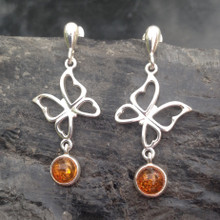 Long sterling silver and Baltic cognac amber butterfly drop earrings