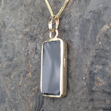 Rectangular Whitby Jet and 9ct gold pendant