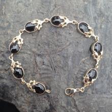 Whitby Jet 9ct gold leaf oval stone bracelet
