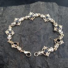 9ct gold Whitby Jet scroll multi stone bracelet
