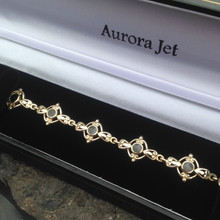 Whitby Jet and 9ct gold round stones fancy bracelet