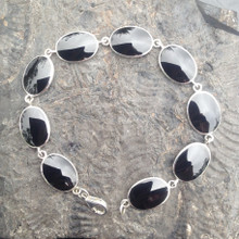 Hand crafted sterling silver and Whitby Jet oval multi stone bracelet