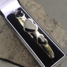 Sterling silver bangle with three hand carved Whitby Jet heart stones