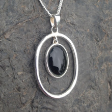 Whitby Jet and sterling silver open oval pendant