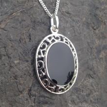 Large oval fancy scroll edge sterling silver Whitby Jet pendant
