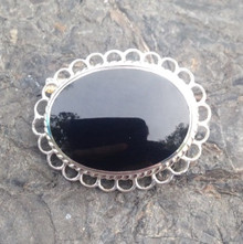 Small oval sterling silver Whitby Jet pin brooch with frill and rope edge