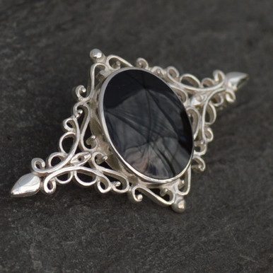 Large sterling silver filigree brooch with oval Whitby Jet stone