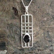 Contemporary sterling silver oblong Mackintosh style pendant with oval Whitby Jet stone