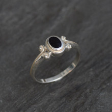 Ladies fancy sterling silver ring with oval Jet stone and scroll shoulder