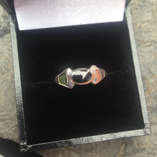 Contemporary sterling silver ring with wide shoulder and oval Whitby Jet stone