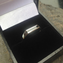 Slim sterling silver signet ring with elongated rectangular Whitby Jet stone