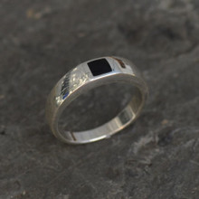 Contemporary sterling silver ring set with flush set square Whitby Jet stone
