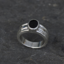 Wide sterling silver ring with oval Whitby Jet stone and ribbed band