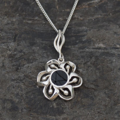 Round Whitby jet flower pendant