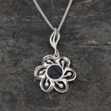 Small sterling silver floral pendant with circular Whitby Jet stone