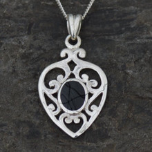 Ornate Whitby Jet heart pendant with sterling silver scroll detailing