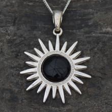 Contemporary sterling silver sun pendant with circular Whitby Jet cabochon