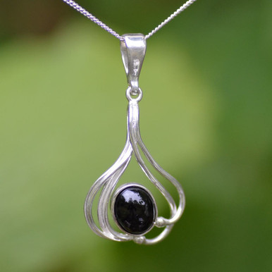 Silver pendant set with locally collected Whitby jet stone