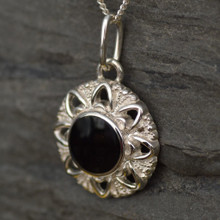 Round sterling silver flower pendant with Whitby Jet