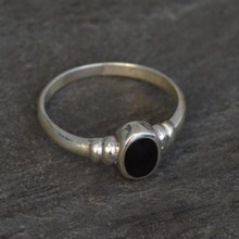 Sterling silver ring with ribbed shoulder and oval Whitby Jet stone