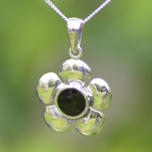 Silver buttercup pendant with round Whitby Jet stone