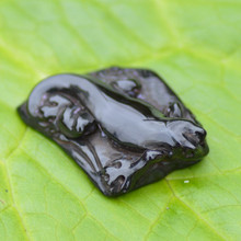 Carved Whitby jet gecko