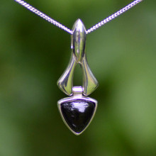 Hand crafted sterling silver pendant with curved triangle Whitby Jet cabochon