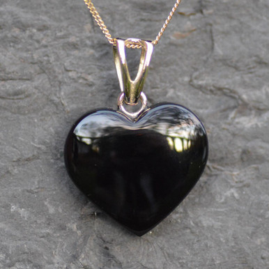 Whitby jet carved heart on yellow gold