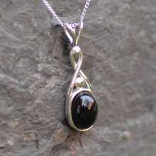 Elegant sterling silver Celtic twist pendant with oval Whitby Jet cabochon