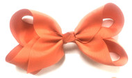 """CLIP BOW ORANGE 6.5"""" Dozen packing, comes on tear-away strip for individual cards."""
