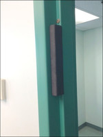 Block the Lock is a rigid foam magnetic block that acts as a silent door stopper to prevent the lock from engaging and securing the door.