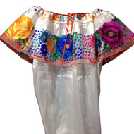 The Chiapas typical blouse is truly a unique work of art; very different from the blouses in other parts of Mexico. It consists of a  full decoration of stripes with colorful and stunning flowers usually embroidered in silk or similar thread (articela) on a black or white background.