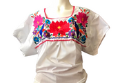 Puebla is a  white blouse embroidered of floral designs in bright colors.