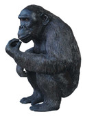 Chimpanzee Eating Statue
